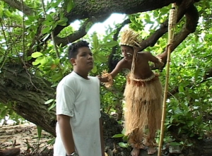 A scene from Na Noniep of the Noniep (Kyle Trevor) and LIki (Randon Jack)
